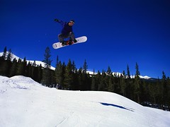 WIN-18PB016-004 (billpennings) Tags: 1 adults adventure balance carefree clearsky colorphotography control copyspace courage enjoyment excitement extremesports freedom fun hill jumping lifestyle males men motion outdoors people photography recreation seasons skiarea skislope skill sky snow snowsports snowboarder snowboarding sports thrillseeking trees whites winter wintersports youngadults