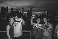 Lots of Selfies at Brooklyn Promenade, NYC (L A Nolan) Tags: 185mmf28 28mmequiv brooklyn brooklynheights dusk fujifilmx70 manhattan newyork newyorkcity newyorknewyork night ny nyc outdoors outside people phone skyline skyscrapers streetphotography thebigapple