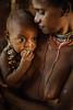 Motherhood (► Antoni Myśliborski ◄) Tags: asia baby grey indonesia korowai mother motherhood papua woman women child naked nude