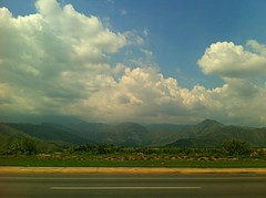 Just passing through (Athesa) Tags: road blue sky verde green apple azul clouds landscape carretera venezuela 4 paisaje cielo nubes montaas maracay iphone aragua