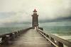 Just off the swirling sea, there's a lighthouse, (soleá) Tags: beacon seagull summer lighthouse ocean vuurtoren atlanticocean europe france travel soleá nature architecture seascape waves carmengonzalez normandy