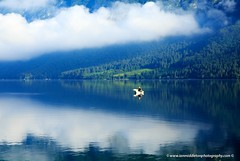 Morning at Lake Bohinj in Slovenia (Ian Middleton: Photography) Tags: park morning travel summer vacation mist lake holiday mountains alps reflection tourism beautiful misty landscape boat julian scenery europe european mood moody famous scenic eu tourist clear slovenia alpine national valley stunning former popular resorts picturesque region bohinj yugoslavia attraction triglav slovenian slovene gorenjska