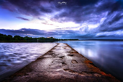 Duality (Ray Moloney Photography) Tags: ifttt 500px pier lake water clouds sky moody blue trees reflection river summer beautiful hour long exposure green night tree ireland county tipperary boats hills light orange stone purple hue motion movement ripples current