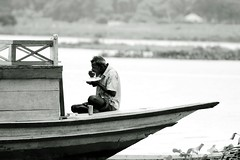 The taste of life (Explored) (Synthia Mazumder) Tags: life food taste boat boatman blackwhite bangladesh