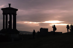 All seems clearer from the top of the hill (dorablanco) Tags: edinburgh canonphoto night caltonhill europe darkness shilouettes dark oscuro siluetas noche people light sunset mistery tradition