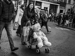 The Bear Necessities (Leanne Boulton) Tags: monochrome urban street candid streetphotography candidstreetphotography streetlife humour humorous juxtaposition fun funny surreal woman female face facial expression look emotion feeling eyes eyecontact candideyecontact teddy bear ted cuddly toy stuffed pushchair pram odd dutchangle tone texture detail depth natural outdoor light shade shadow city scene human life living humanity society culture people canon 5d 5dmkiii 50mm character ef2470mmf28liiusm black white blackwhite bw mono blackandwhite glasgow scotland uk