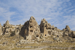 Man made caves (Christopher-James Brame) Tags: caves travel turkey goreme cappodacia sky rocks rock formation clouds day
