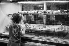 Just Looking! (doriboyd) Tags: moments child cupcakes urban sweet story monochrome decisivemoment candid