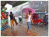 Pink brolly and green coathanger. (the jacal) Tags: cambodge cambodia asia umbrella khmer street streetphotography smile khmersmile phnompenh indochina indochine rain monsoon urban urbanphotography
