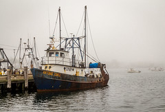 Fishing boat in the fog (ronnymariano) Tags: ocean morning travel vacation sky beach nature fog clouds bay boat us lowlight ship unitedstates provincetown capecod massachusetts gray fishingboat ptown densefog 2015