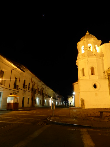 Partially-eclipsed moon near the Santo Domingo church in Popayan