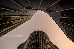 Coderch. (arturii!) Tags: barcelona light sunset sky reflection building tower window glass architecture composition skyscraper dark office europe dancing bcn catalonia lookingup diagonal architect round shape faade arquitecture coderch