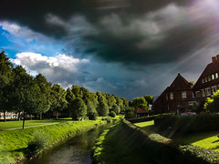 Dark clouds and sunshine (betadecay2000) Tags: park urban sun green water sunshine weather clouds river germany deutschland cloudy wolke wolken bach stadt grün sonne parc wetter stadtpark meteo weer coesfeld flus