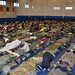 Service members attached to Joint Task Force Guantanamo Bay take shelter inside Denich Gym before Hurricane Matthew hits Naval Station Guantanamo Bay.
