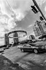 2016-10-26-0008 (alexdotbarber) Tags: 1meter 1250 35mm houstongalleria kodaktmax100 voigtlanderbessal voigtlandersuperwideheliar15mmf45 blackandwhite chrome f8 intersection traffic underexposed
