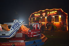 crazy circus and carousel ride (PGview) Tags: guyfawkes roundtable carousel community lights clown public rubbish trash tree chopperrescue grass nypd crazycircus northwest circus england cheshire fireworks bonfire uk family friends funn luminous night