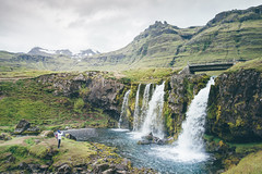 Kirkjufellsfoss, Snæfellsnes. (Matthieu Robinet) Tags: iceland island islande roadtrip falls waterfall alone lonely landscape amazing nature green snow summit mountains depth escape explore discover travel rocks cascades paysage relief tranquility zen meditation soft bridge vsco exposure delight dream grey summer cloudy peninsula west northatlantic coast arctic ice moss lychen