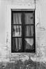 Broken glass (Eduardo Estéllez) Tags: blancoynegro cortina portugal vertical ventana monocromo madera vieja ruina antigua cortinas alentejo cristal evora vidrio roto abandono cristales nadie abandonado rotura dejado contraventanas visillos deteriorado deshabitado cristalesrotos eduardoestellez estellez