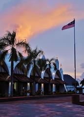 Malaysian skies (SM Tham) Tags: trees sunset sky building clouds palms island flag malaysia shops langkawi flagpole eaglesquare dataranhelang