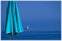 Calma ..... (Schano) Tags: landscape mediterraneo mare calma paesaggio barcaavela ombrellone picmonkey ilce3000 sonyilce3000 sonyemount55210 sony3000