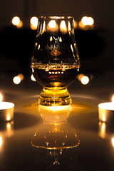 Whisky - Another love (Explore #17) (Fabian Fortmann) Tags: light orange black reflection glass canon lights licht candle drink bokeh sigma whiskey kerze symmetry whisky 1770 schwarz kerzen glas lichter reflektion teelicht getränk singleton firewater symmetrie feuerwasser 700d jawroskyj