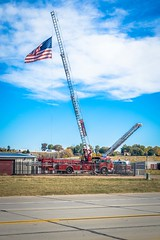 Cool storage facility with several ladder trucks.