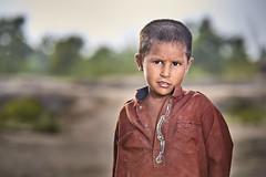 (KHK Images) Tags: portrait boy village outdoor natural bokeh green day nomads homeless sad poor education basic needs rights governance