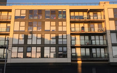 Late in the day (d.murphy) Tags: evening sun autumn sunset apartment lines boxes