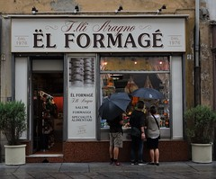 """Say: """"Cheese"""" ! (France-) Tags: 1257 cheese formag italy torino turin umbrella parapluie persone store magasin italia food window fentre candid piedmont fromage elformag mots shopping formaggio"""