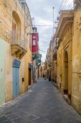 A narrow street in Rabat, Malta (thorrisig) Tags: 02112016 malta rabat gtumynd thorrisig thorfinnursigurgeirsson thorri orrisig thorfinnur orfinnur orri orfinnursigurgeirsson sigurgeirsson sigurgeirssonorfinnur dorres street houses hs gata city