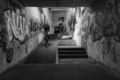 Ghost tunnel (Verstrepen Geert) Tags: street people bycicle streetphotography black white blackandwhitephotography photography tunnel graffiti