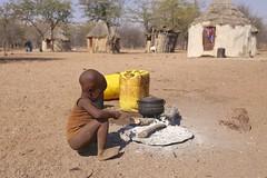 Himba village life (Andrzej Olszewski) Tags: namibia africa safari child himba