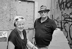 The Gatherers (geowelch) Tags: toronto blackwhite 35mmfilm kensingtonmarket streetportraits xp2super400 honeywellvisimatic615 streetlevelphoto plustekopticfilm7400