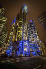 Lloyd's of London (balstillz) Tags: street city light england building london yellow metal night purple structure lloyds lloydsoflondon