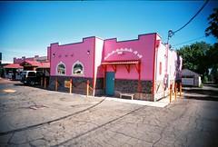 La Fiesta (jfpj) Tags: pink white color green film oregon restaurant colorful bright toycamera mexican vivitar plasticcamera mexicanrestaurant trashcam lagrande plasticlens 10faves vivitarultrawideandslim