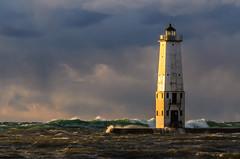 Sun King (Aaron Springer) Tags: sunset lighthouse storm nature weather waves outdoor michigan lakemichigan maritime nautical lanscape stormlight whitecaps northernmichigan thegreatlakes frankfortmichigan novembergale frankfortlighthouse