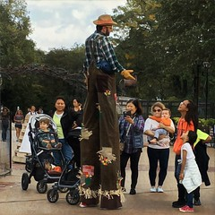Stilted (Renee Rendler-Kaplan) Tags: he him stilts upthere personable friendly people peoplestanding peoplesitting peoplewalking zoo lincolnparkzoo lincolnpark autumn october 2016 iphone iphoneography stilted chicagoist chicagoillinois chicagoreader wbez strollers kids adults there up reneerendlerkaplan tall outdoors outside working employee employed consumerist aboveitall abovethefray sit sitting seated