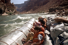 35-047 (ndpa / s. lundeen, archivist) Tags: nick dewolf nickdewolf color photographbynickdewolf 1970s 1973 1972 film 35mm 35 reel35 arizona northernarizona southwesternunitedstates canyon marblecanyon grandcanyon coloradoriver raftingtrip raftingexpedition rafting river riverrafting water whitewater rapids people lifejackets lifepreservers floatationdevices raft inflatable sanderson sandersonraftingexpeditions sandersonriverexpeditions srig children kids child boy girl quentin hat nicole girls barefoot