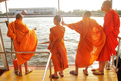 Krung Thep, the city of angels (slow paths images) Tags: thailand bangkok krungthep thecityofangels southeastasia city men thai monks four group standing robes orange bouddhists buddhism lifeinbangkok streetphotography river boat publictransport chaophraya light daylight sunshine travel fredcan