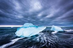 Chunks of ice (modesrodriguez) Tags: 2016 iceland islandia landscape paisaje travel viaje blacksand beach ice water silkeffect sky clouds dramatic wet jokulsarlon