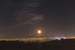 Moon over bridge (langdon10) Tags: bridge canada canon70d moonlight nighttime quebec shoreline stlawrenceriver handheld longexposure moon