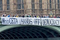 Westminster Bridge banner drop against TTIP & CETA (The Weekly Bull) Tags: ceta ttip bis transatlantictradeandinvestmentpartnership comprehensiveeconomicandtradeagreement eu europeanunion canada trade treaty capitalism corporatecontrol greenparty jeanlambert protest demonstration london uk westminsterbridge