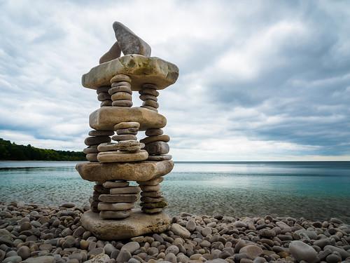 Stone Monolith at the Shore's Edge