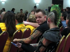 Dude, I'll put my arm anywhere I want to. (kennethkonica) Tags: costumes friends people usa haircut color men leather yellow tattoo america canon hair midwest sitting faces chairs skin cosplay random expression candid indianapolis seat indy talk indiana buddy sit cons mohawk persons talking seated canonpowershot tatts blackclothes costumecontest horrowhound costumecontestroadwarrior