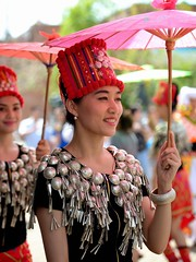 Chinese girl from Dehong under pink umbrella, Yunnan (adamba100) Tags: life china street city trip travel light boy portrait people woman man color colour cute male men tourism lamp girl beautiful beauty face female children landscape asian person star town canal costume kid interesting women asia pretty vietnamese cityscape child play dress view outdoor traditional innocent sightseeing chinese decoration beijing lifestyle style charm korea headshot tourist vietnam mongolia korean human thai innocence lantern gadget pure channel pendant purity garb mongolian attire