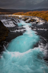 Bruarfoss (palnick) Tags: blue sunset sky sun motion cold color detail tourism nature water colors beautiful beauty rock horizontal stone river landscape flow outdoors waterfall iceland spring colorful warm power scenic wave nobody cascade bruara bruarfoss
