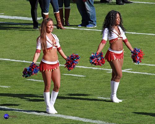 Redskinette Cheerleaders Jackie and London on the field.