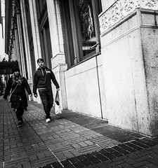 Stepping In Unison (TMimages PDX) Tags: street city people urban blackandwhite monochrome buildings portland geotagged photography photo image streetphotography streetscene sidewalk photograph pedestrians pacificnorthwest vignette fineartphotography iphoneography
