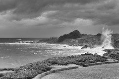 Seaside Home (rschnaible) Tags: ocean sea bw usa white black west water clouds landscape photography coast us seaside san rocks pacific cloudy outdoor rocky wave monotone coastal western mateo rugged