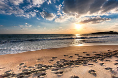 Cloudy sunset over a deserted beach of Crete (envylight) Tags: ocean sunset sky sun seascape reflection beach nature beauty weather sunrise dawn solitude peace cloudy dusk sandy horizon scenic orb environment seashore deserted atmospheric celestial